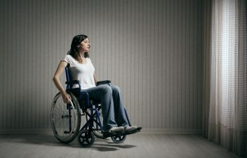 photodune-4814427-sad-woman-sitting-on-wheelchair-m.jpg